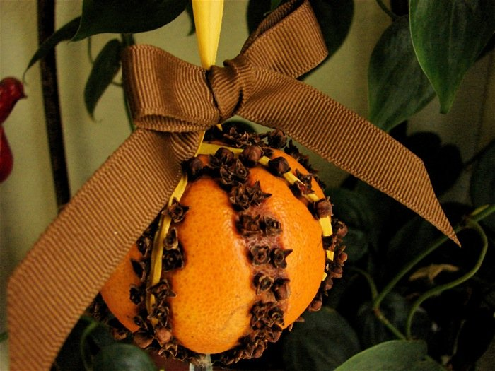 orange clove ball pomander ornament with ribbon