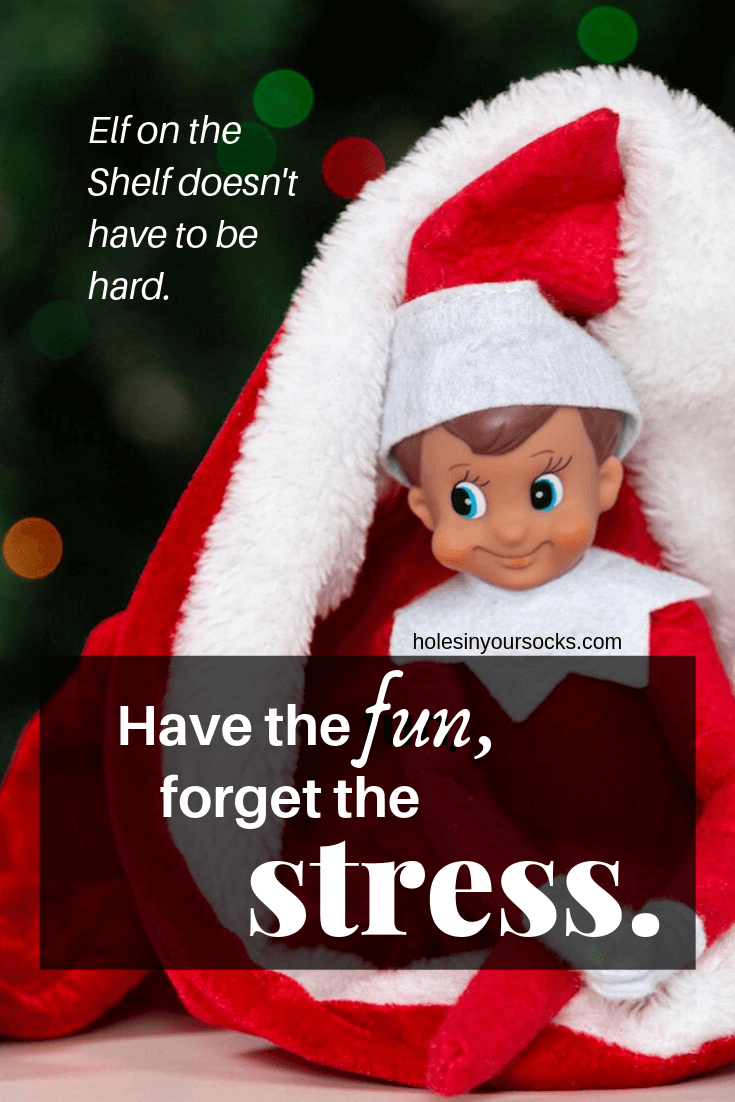 Elf on the Shelf smiling in a santa hat. Have the fun, forget the stress. Elf on the Shelf doesn't have to be hard.