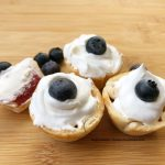strawberry mini pies with blueberries and whipped topping
